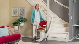 Cama chairlift for stairs with curves