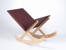 Merry Foot tilting stool in wood